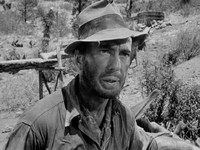 Humphrey Bogart as Fred C. Dobbs.