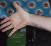 He also tries to cover up the fact that he has Xbox boxes under his table.