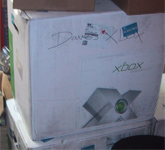 Dave's Xbox, apparently. At the back of Double Fine we find loads of strange things, (see below) but amongst them, boxes of equipment.