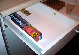 The drawer where Tim Schafer lost his parmesan cheese, now featuring a rat trap.